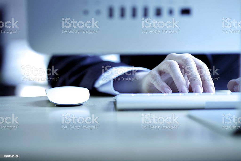 Typing behind the screen royalty-free stock photo