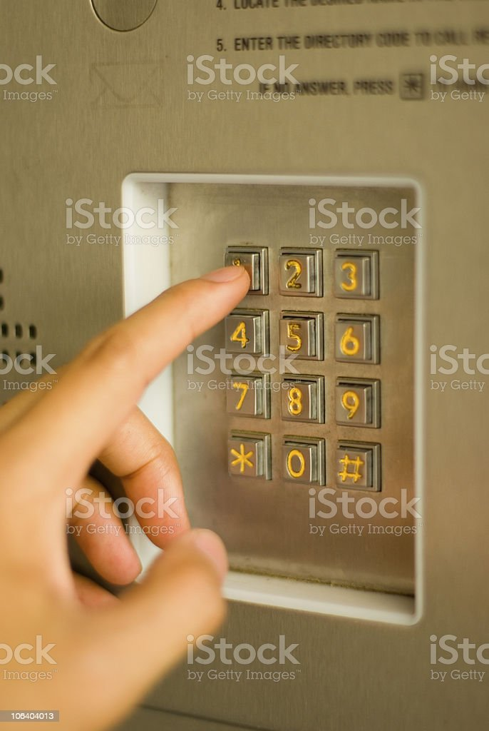 Typing in a secret pin code royalty-free stock photo