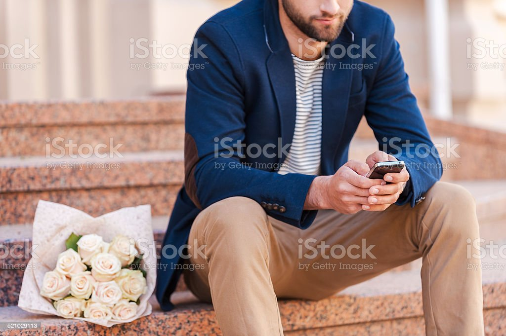 Typing message to girlfriend stock photo
