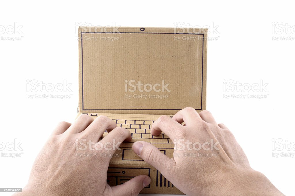 Typing on a cardboard laptop royalty-free stock photo