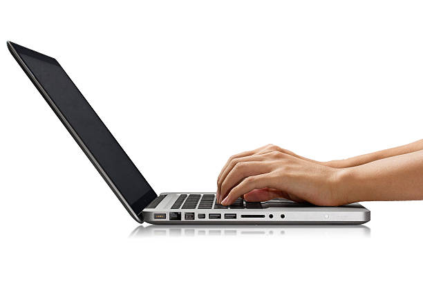 Typing on a Laptop Young Asian male using a laptop/macbook pro. Fingers on the trackpad. touchpad stock pictures, royalty-free photos & images