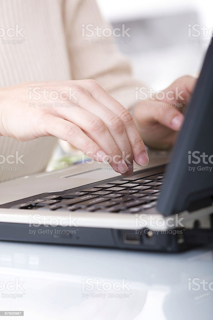 typing on a laptop royalty-free stock photo