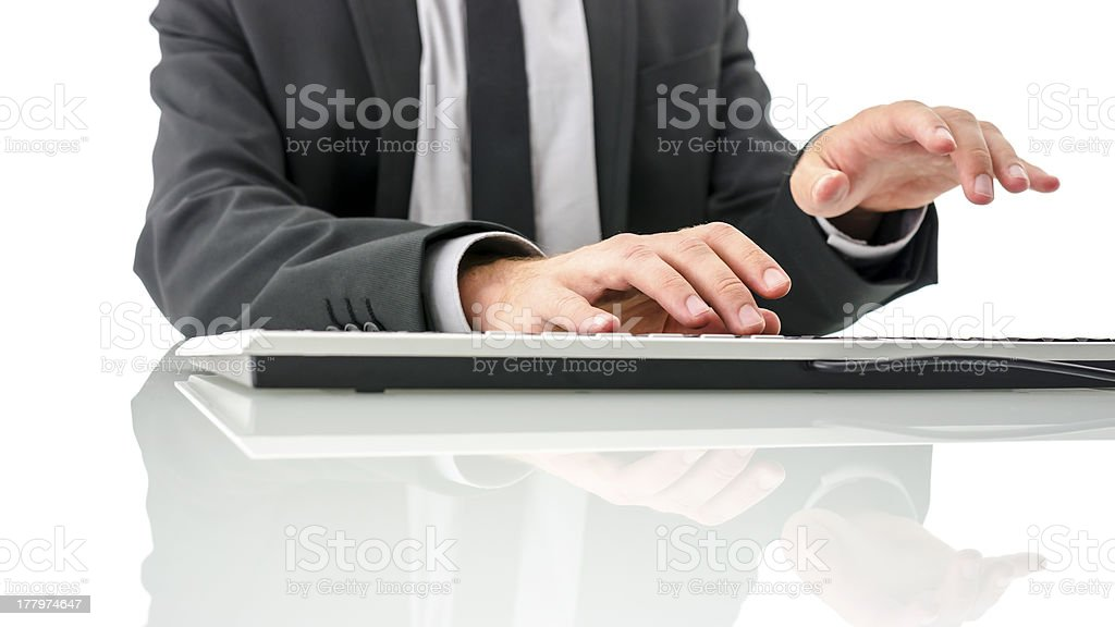 Typing on computer keyboard stock photo