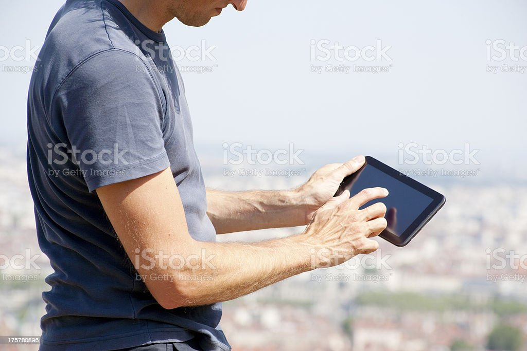 Typing on digital tablet royalty-free stock photo