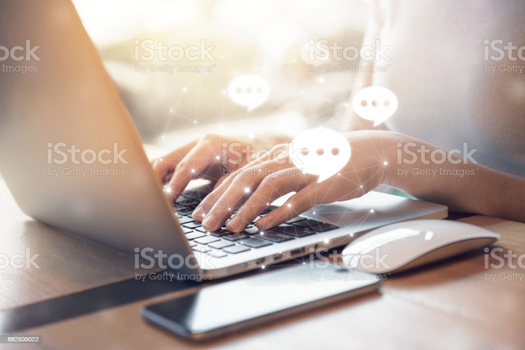 Typing on keyboard laptop Live Chat Chatting on application stock photo