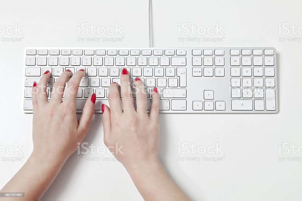 typing on keyboard stock photo