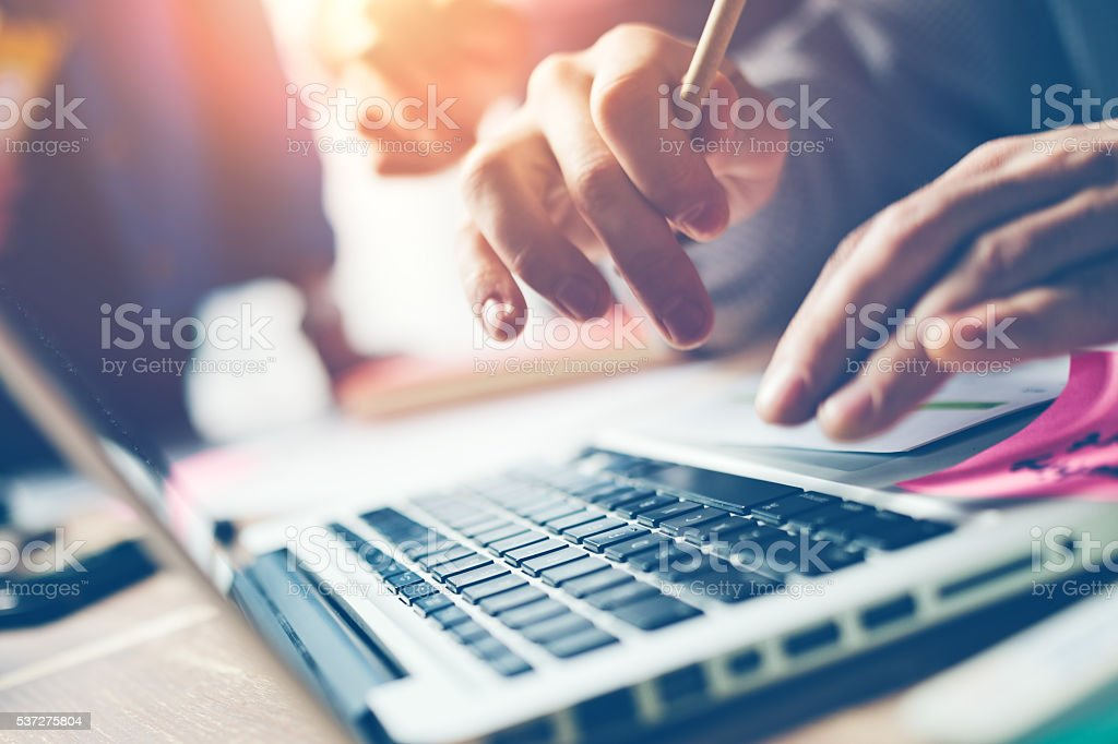 Typing on laptop close-up stock photo