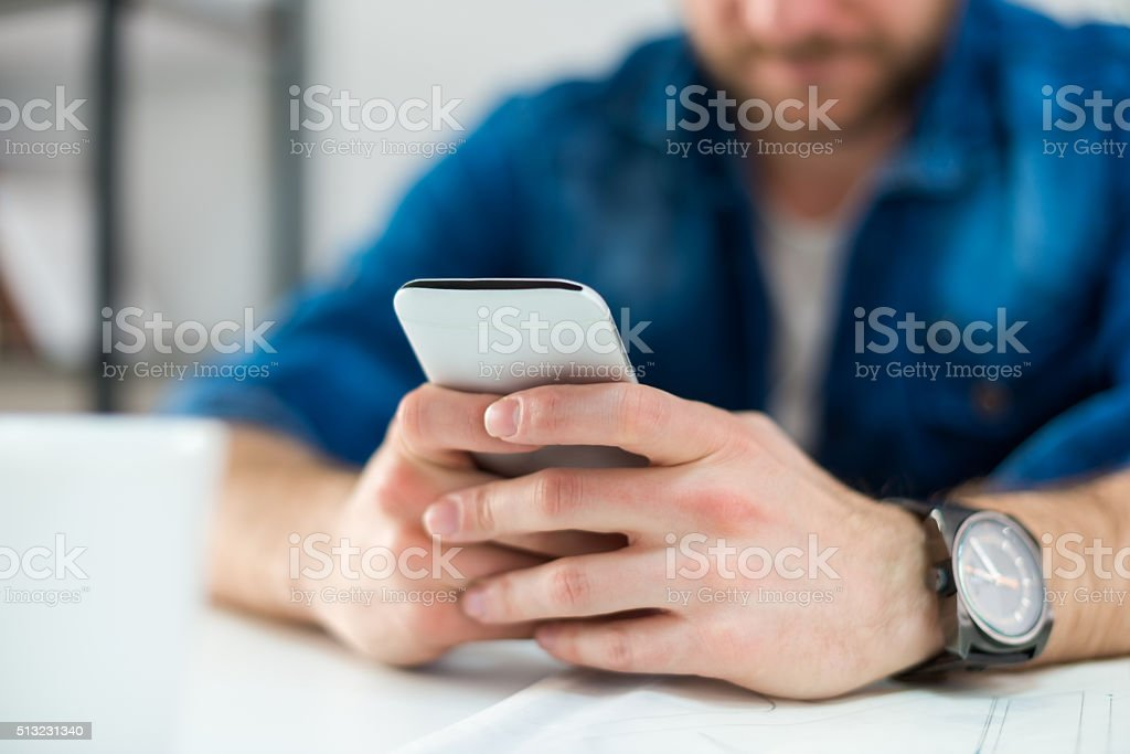 Typing on Smart phone stock photo