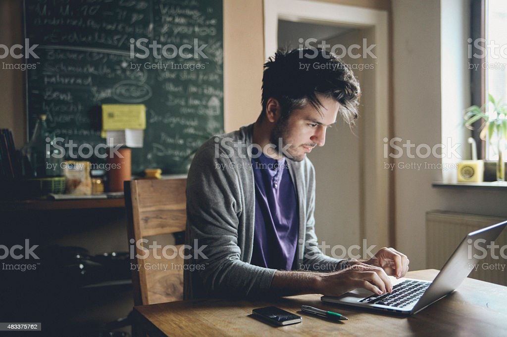 typing on the laptop computer stock photo