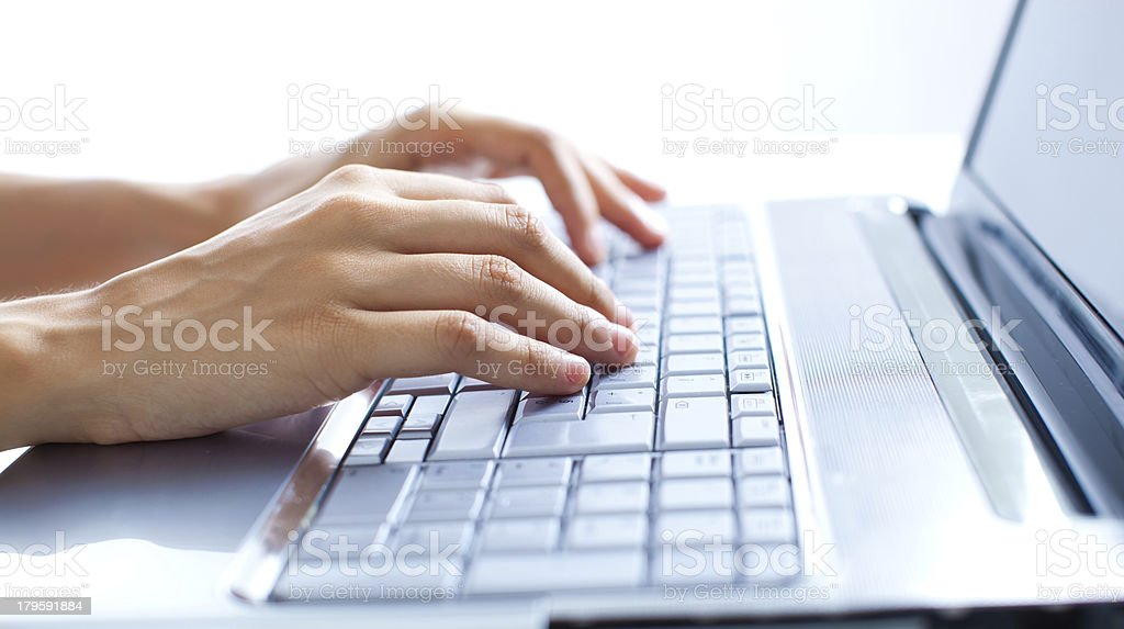 Typing on the laptop - Royalty-free Close-up Stock Photo