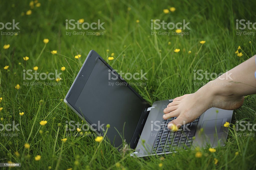 Typing with toes royalty-free stock photo