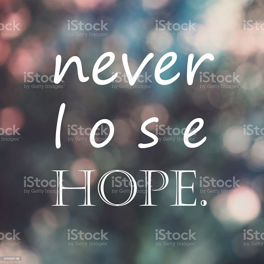 Typography Positive quote ,'never lose hope' on blur bokeh background stock photo