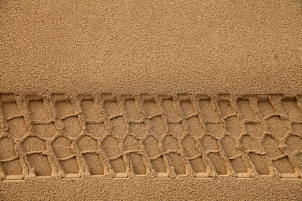 Tyre Track in Sand Tyre Track in Sand after rain tire track stock pictures, royalty-free photos & images