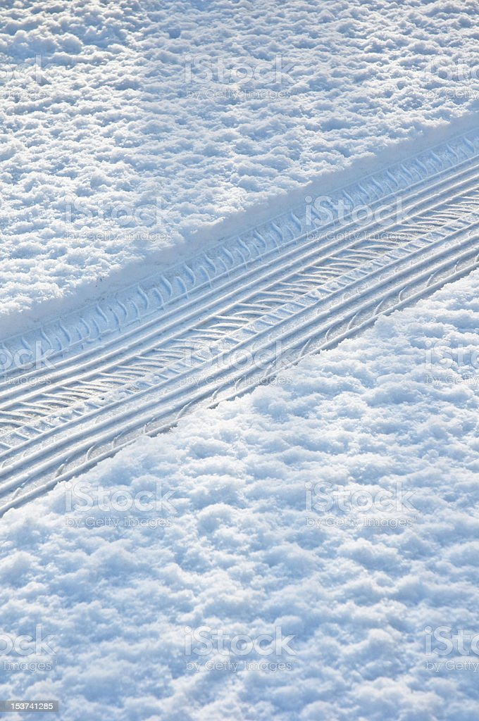 tyre track in the snow royalty-free stock photo