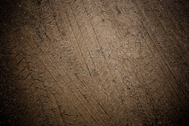 Tyre track on dirt sand or mud, retro tone, grunge tone, drive on sand, off road track Chiangmai, Thailand tire track stock pictures, royalty-free photos & images