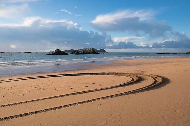 Tyre tracks at Tauranga Bay, Northland, NZ stock photo