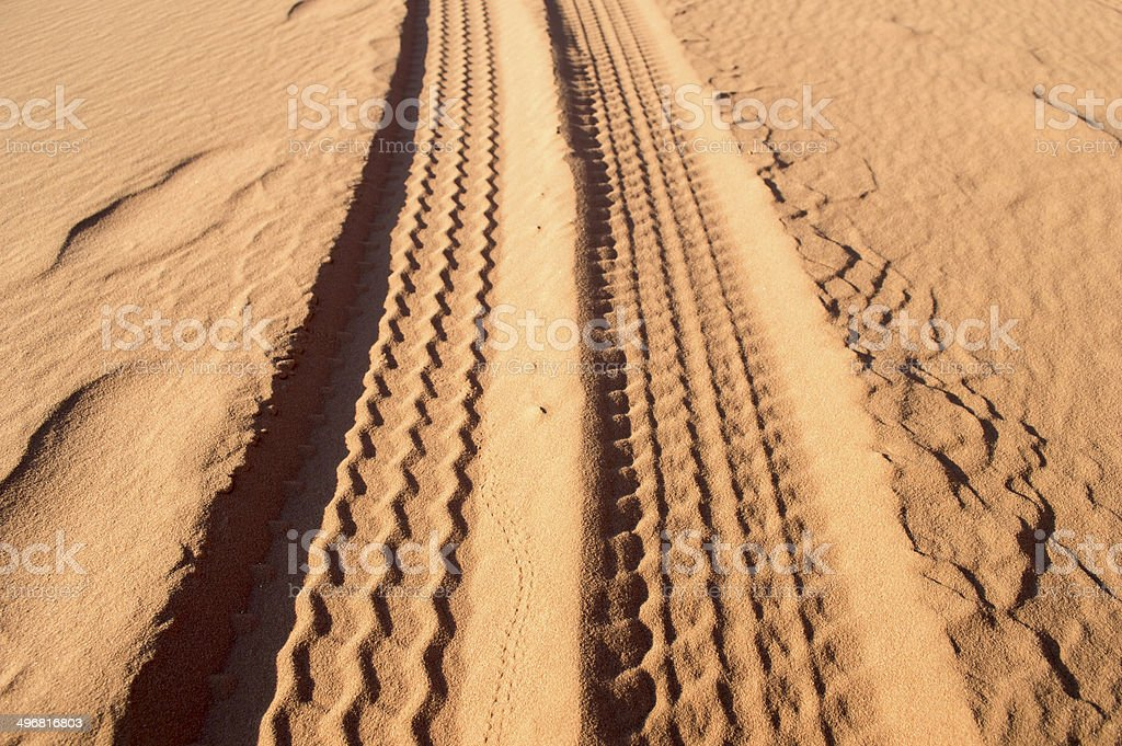 tyre tracks on the sand royalty-free stock photo