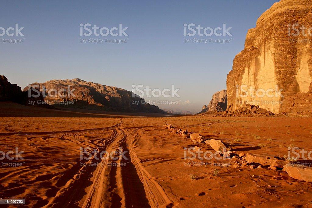 Tyre Tracks through the Sand at Sunset, Wadi Rum, Jordan stock photo