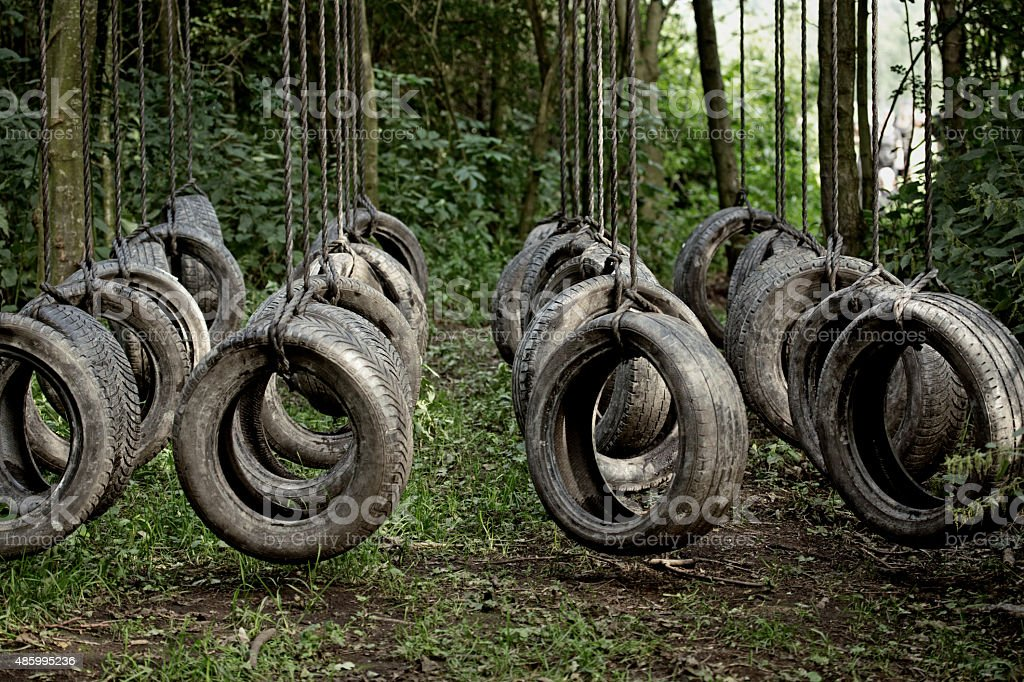tyres obstacle at the forest stock photo