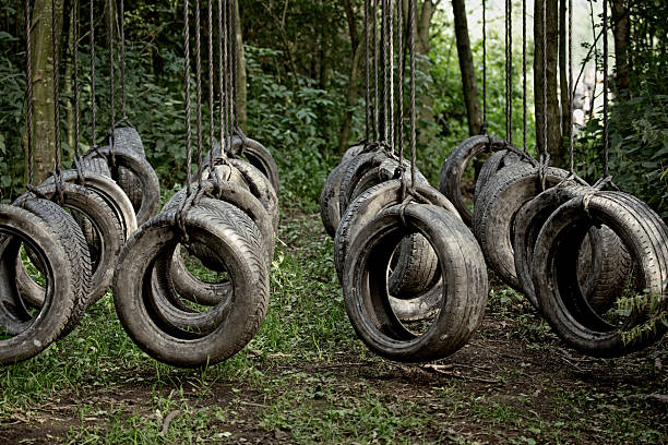 tyres obstacle at the forest tyres obstacle at the forest mud run stock pictures, royalty-free photos & images