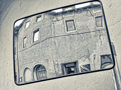 Traffic mirror view of a street  in the countryside region of Trentino-South Tyrol and the Dolomites in Italy