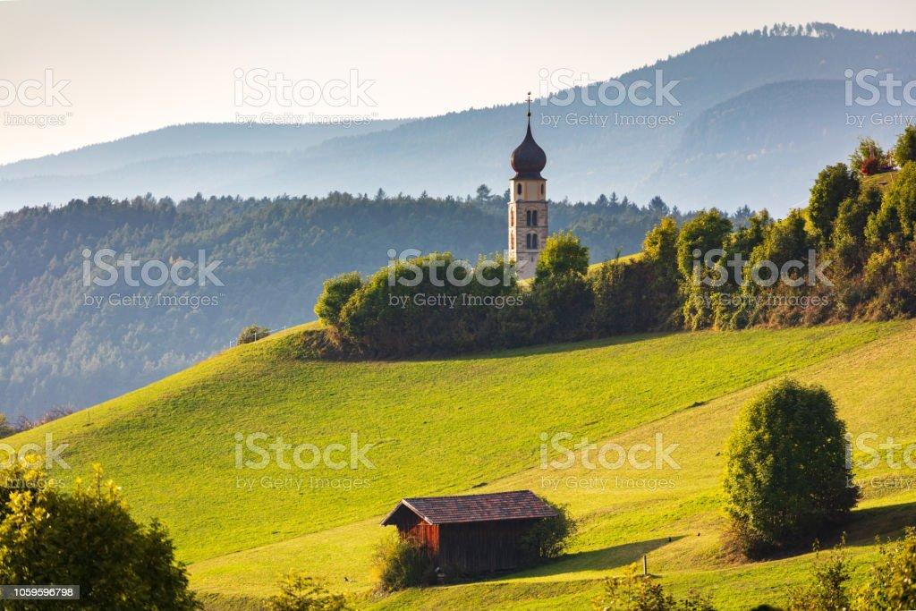 Tyrolean church with a clocktower stock photo
