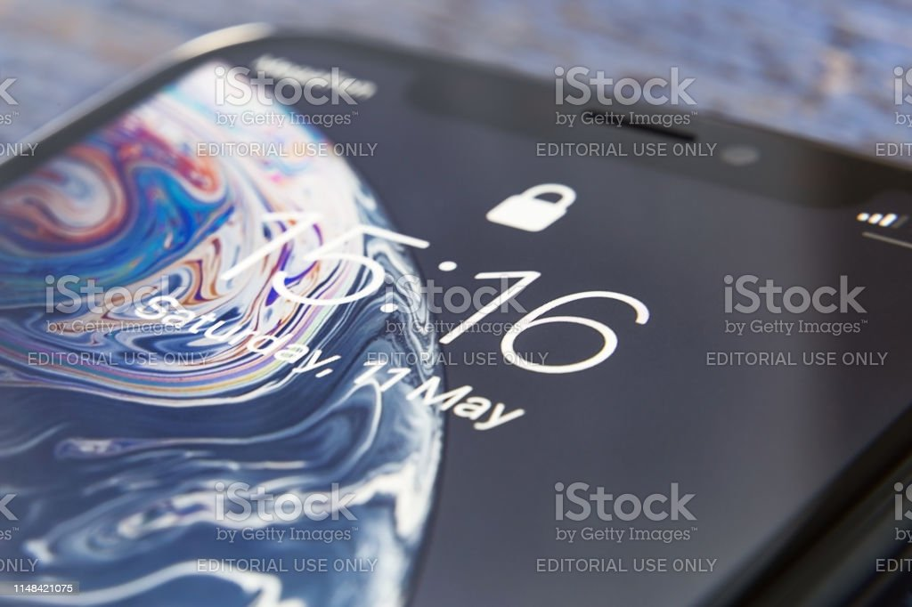 Tyumen, Russia - May 11,2019: Apple iPhone XR device screen close up Tyumen, Russia - May 11,2019: Apple iPhone XR device screen close up Apple Computers Stock Photo