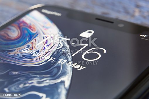 Tyumen, Russia - May 11,2019: Apple iPhone XR device screen close up