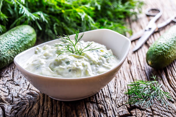 Tzatziki. Traditional greek dip sauce or dressing tzatziki prepared  with grated cucumber sour cream yogurt olive oil and fresh dill. Mediterrannan cuisine Tzatziki. Traditional greek dip sauce or dressing tzatziki prepared  with grated cucumber sour cream yogurt olive oil and fresh dill. Mediterranean cuisine. dill stock pictures, royalty-free photos & images