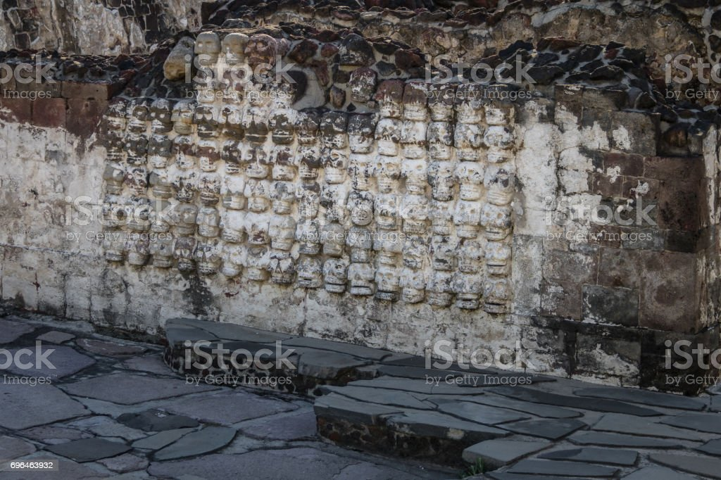 Tzompantli altar with carved Skulls rows in Aztec Temple (Templo Mayor) at ruins of Tenochtitlan - Mexico City, Mexico stock photo