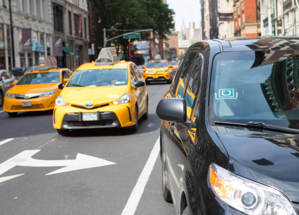 Uber and New York City Taxi stock photo