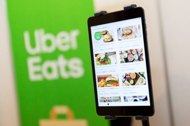 uber eats app and logo - food logo stock photos and pictures
