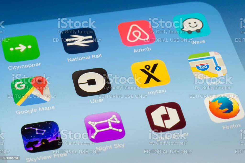 Uber, mytaxi and other travel Apps on iPad screen stock photo