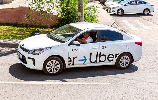 istock Uber taxi goes down the street 1155066211