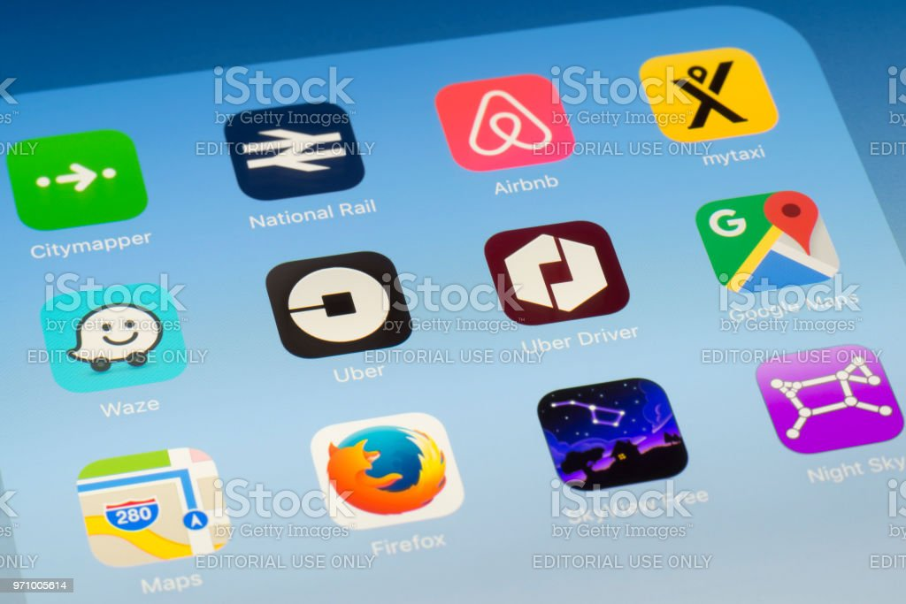 Uber, Uber Drive and other travel Apps on iPad screen stock photo