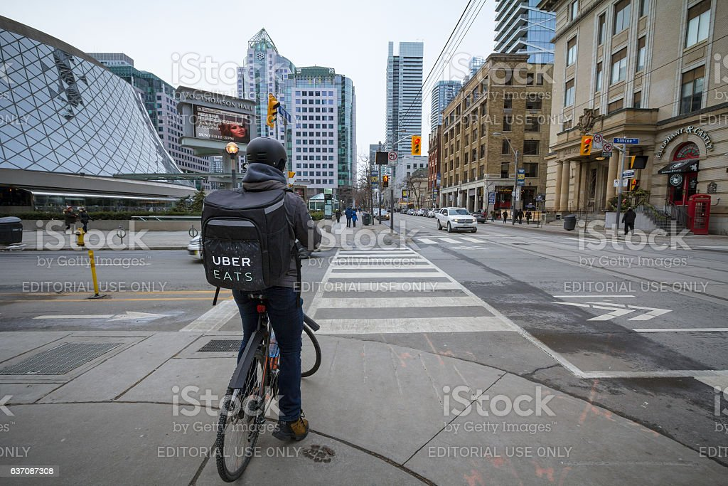 UberEats delivery man on a bicycle in Toronto stock photo