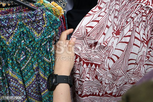 Ubud market is a famous market in bali a lot of tradition handcraft product just like traditional bali style costume and wooden souvenirs for tourist attraction,Bali,Indonesia