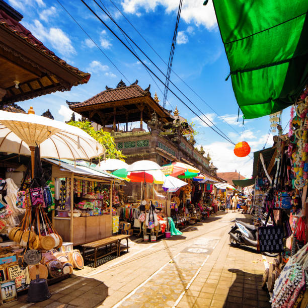 Ubud street market stalls on a sunny day in Bali Indonesia Ubud street market stalls selling a vast array of souvenirs, textiles and craft products on a sunny day in Bali Indonesia asian market stock pictures, royalty-free photos & images