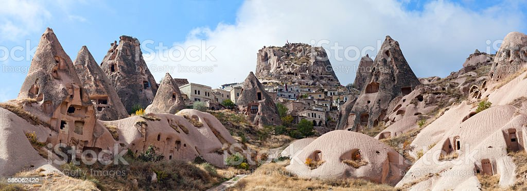 Uchisar castle and unique geological formations in Cappadocia, T stock photo
