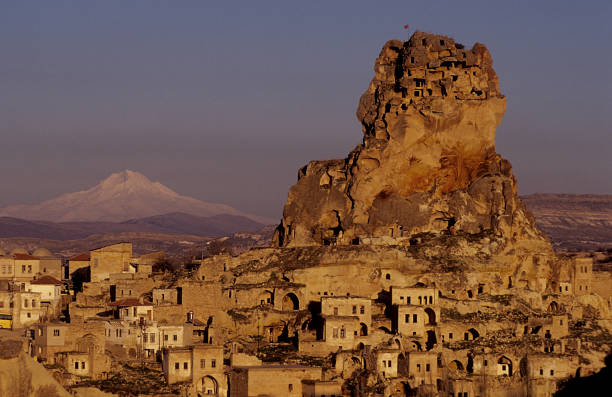 Uchisar Castle in Cappadocia at sunset, Turkey stock photo