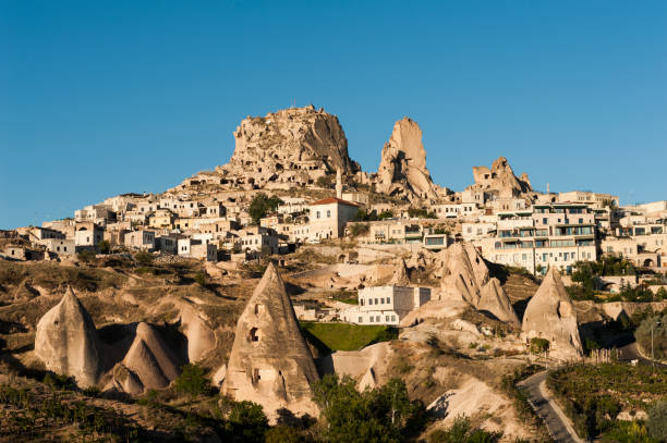 Uchisar Ancient town and a castle of Uchisar dug from a mountains after sunrise, Cappadocia, Turkey anatolia stock pictures, royalty-free photos & images