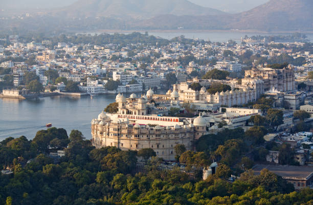 Udaipur City and lake Pichola in Rajasthan state, India Panoramic aerial view of the Udaipur City palace and lake Pichola in Rajasthan state, India lake pichola stock pictures, royalty-free photos & images