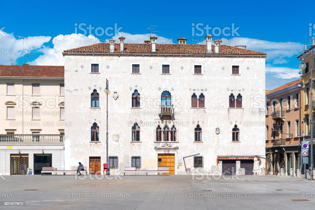 Udine, Italy: Typical Italian house in Venetian style on the square of Udine in sunny day with blue sky stock photo