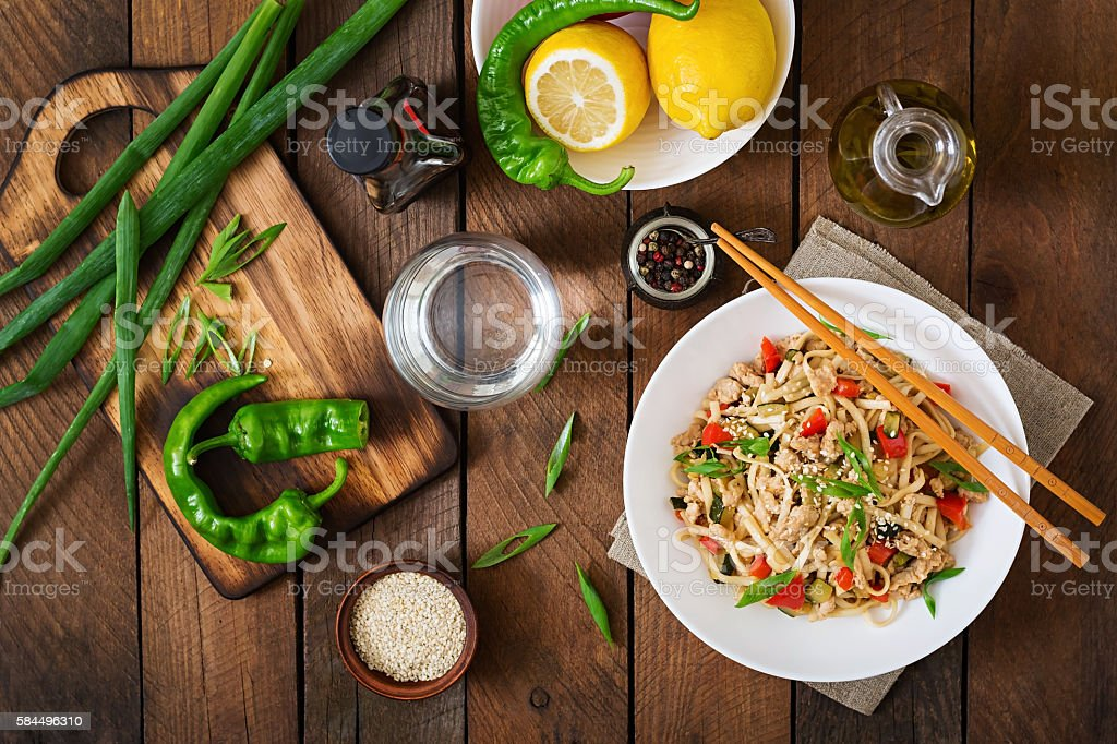 Udon noodles with meat and vegetables in an Asian style. stock photo