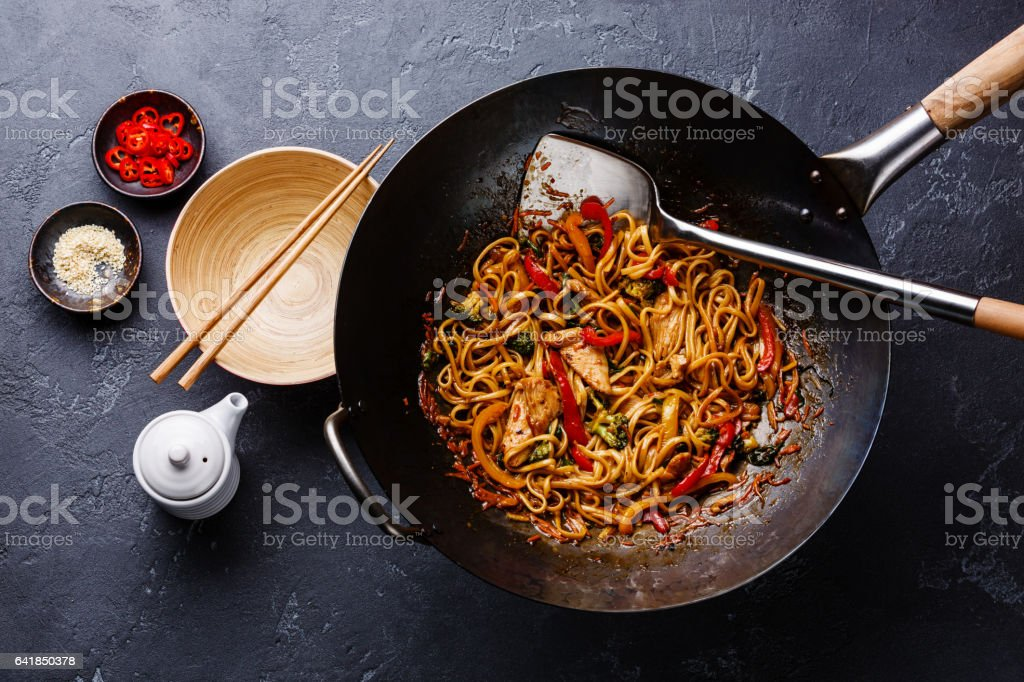 Udon stir-fry noodles with chicken and vegetables stock photo