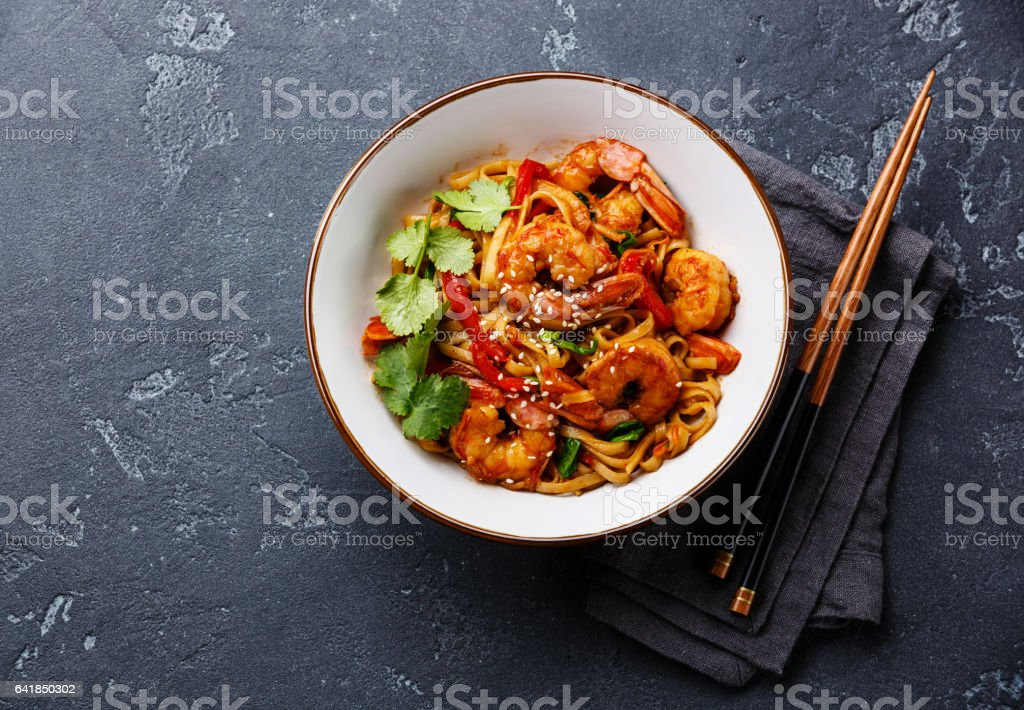 Udon stir-fry noodles with shrimp in bowl stock photo