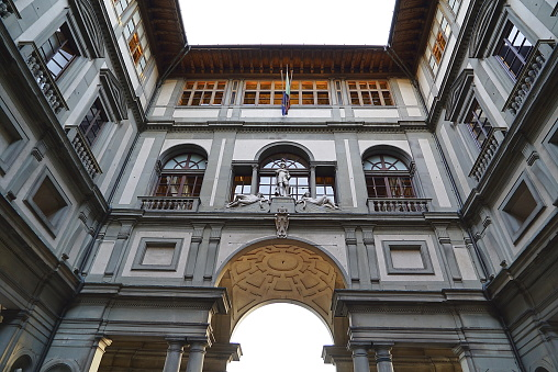 The entrance of the Uffizi Gallery in Florence, Italy with Michelangelo's famous sculpture, David