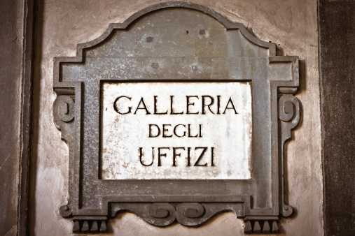 The original stone sign of the Galleria degli Uffizi in the famous exterior corridor of Florence (Tuscany, Italy).