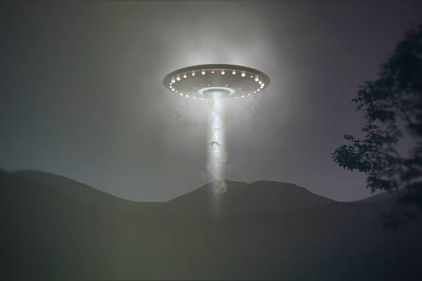 ufo abduction stock photo