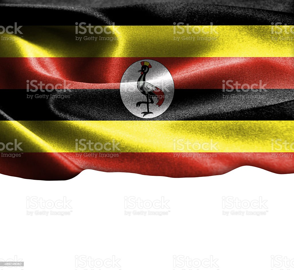 Uganda flag on smooth silk texture Space for Text stock photo